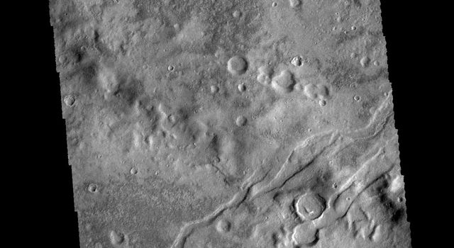 The channel-like features in this image from NASA's 2001 Mars Odyssey spacecraft are tectonic graben. The graben (called Icaria Fossae) are located in Terra Sirenum.