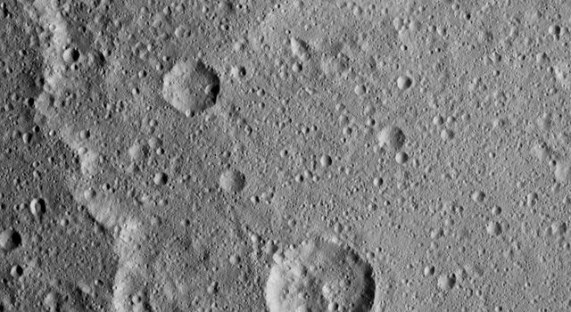 Kerwan Crater, at 174 miles (280 kilometers) in diameter is the largest crater that NASA's Dawn has discovered on Ceres. A portion of its jagged rim runs from the top left to bottom center of this image.
