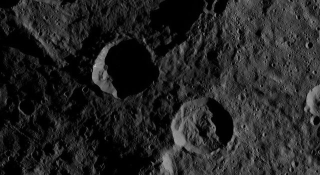 This southern hemisphere scene from dwarf planet Ceres encompasses parts of the craters Mondamin and Darzamat. Mondamin is large crater located in the top half of image, Darzamat is at bottom-right. NASA's Dawn spacecraft took this image on Oct. 19, 2016.