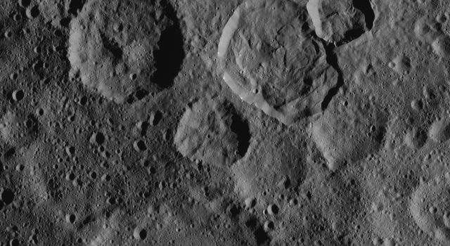This northern hemisphere scene from NASA's Dawn spacecraft, taken on Oct. 20, 2016, features Ceres' Messor Crater, exhibiting a flow feature from the collapse of the rim of an adjacent crater.