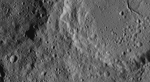 Ceres' Ezinu Crater is seen at top right in this image from NASA's Dawn spacecraft taken on Oct. 21, 2016. The crater features a network of canyon-like features.