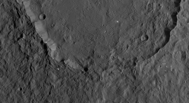 Dantu Crater on Ceres, at top center, is featured in this image from NASA's Dawn spacecraft taken on Oct. 21, 2016. A small crater located around the 5 o'clock position within Dantu is called Centeotl.
