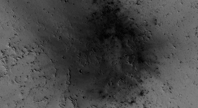 NASA's Mars Reconnaissance Orbiter has been observing Mars in sharp detail for more than a decade, enabling it to document many types of changes, such as the way winds alter the appearance of this recent impact site.