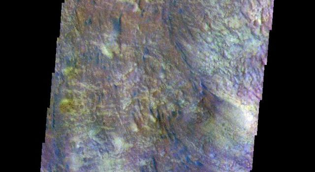 The THEMIS camera contains 5 filters. The data from different filters can be combined in multiple ways to create a false color image. This image from NASA's 2001 Mars Odyssey spacecraft shows some of the floor of Newton Crater.