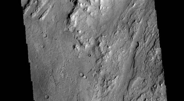 This image captured by NASA's 2001 Mars Odyssey spacecraft shows graben called Claritas Fossae.