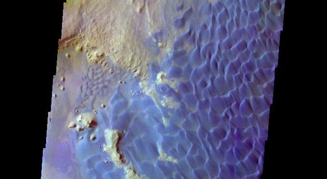 The THEMIS camera contains 5 filters. The data from different filters can be combined in multiple ways to create a false color image. This image from NASA's 2001 Mars Odyssey spacecraft shows part of the sand dune field on the floor of Rabe Crater.