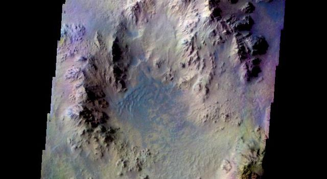 The THEMIS camera contains 5 filters. The data from different filters can be combined in multiple ways to create a false color image. This image from NASA's 2001 Mars Odyssey spacecraft shows part of the interior of Hale Crater.