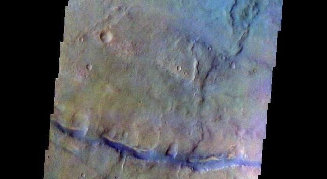 The THEMIS camera contains 5 filters. The data from different filters can be combined in multiple ways to create a false color image. This image from NASA's 2001 Mars Odyssey spacecraft shows part of the plains of Thaumasia Planum.