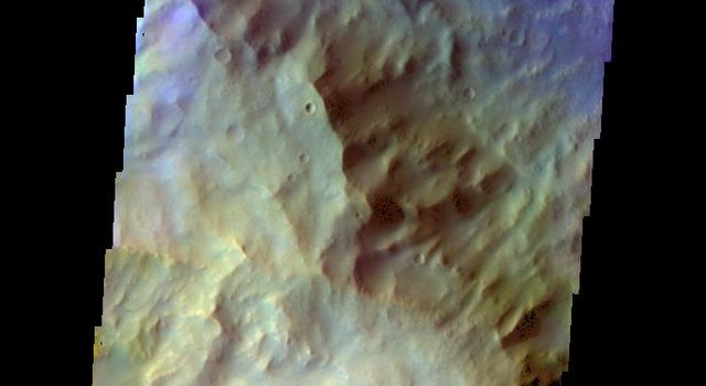 The THEMIS camera contains 5 filters. Data from different filters can be combined in multiple ways to create a false color image. This image from NASA's 2001 Mars Odyssey spacecraft shows part of the southwestern rim of Knobel Crater.