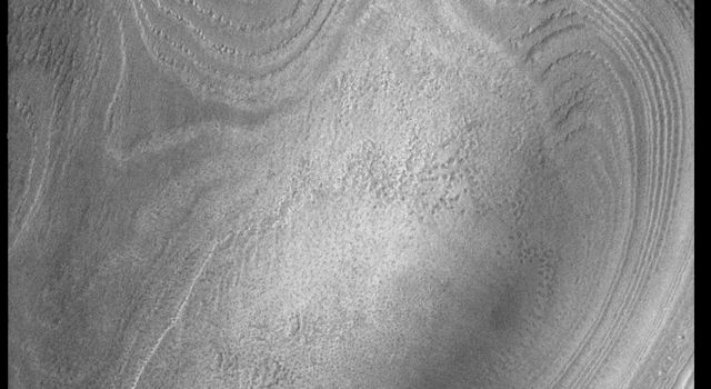 This image captured by NASA's 2001 Mars Odyssey spacecraft shows part of the south polar cap. It is now summer in the region and the surface frosts are gone.