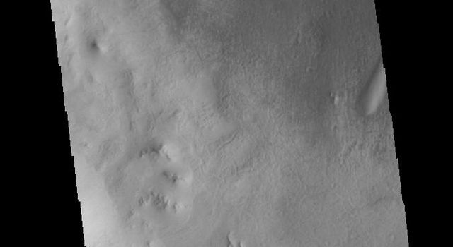 This image captured by NASA's 2001 Mars Odyssey spacecraft shows Ross Crater in Aonia Terra.