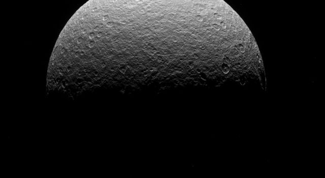 This image is of NASA's Cassini spacecraft's final observation of Saturn's icy moon Rhea on May 2, 2017. The spacecraft was at the time high above the plane of Saturn's rings, looking down at Rhea's northern hemisphere.