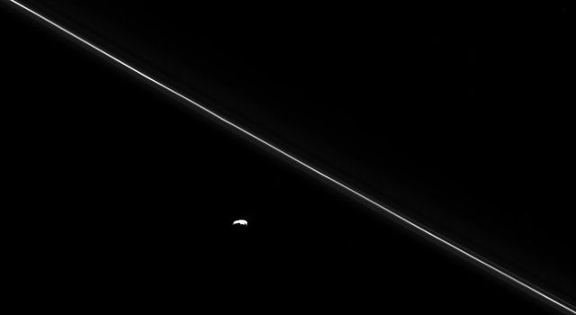 As NASA's Cassini hurtled toward its fatal encounter with Saturn, the spacecraft turned to catch this final look at Saturn's moon Pandora next to the thin line of the F ring.