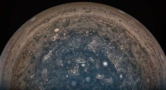 NASA's Juno spacecraft soared directly over Jupiter's south pole when JunoCam acquired this image on February 2, 2017. This enhanced color version highlights the bright high clouds and numerous meandering oval storms.
