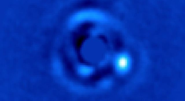 This image shows brown dwarf HIP 79124 B, located 23 times as far from its host star as Earth is from the sun.