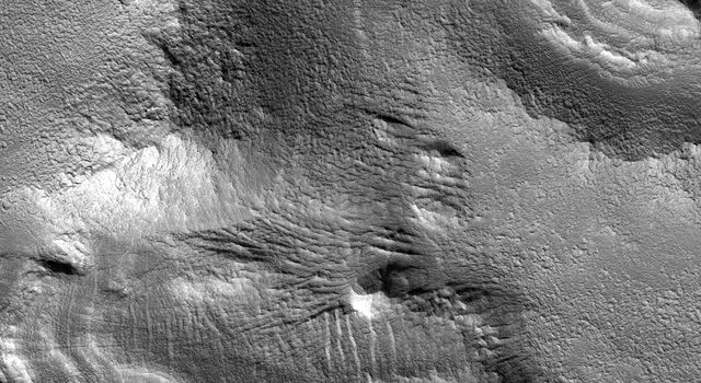 NASA's Mars Reconnaissance Orbiter sees ice-rich mantling deposits accumulate from the atmosphere in the Martian mid-latitudes in cycles during periods of high obliquity.