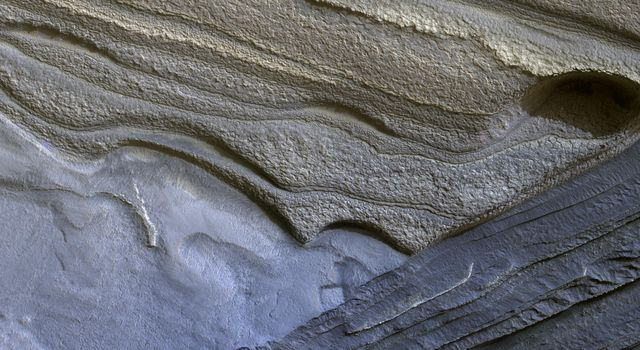 This image from NASA's Mars Reconnaissance Orbiter shows Mars' north polar layered deposits are a thick stack of dusty water ice layers.