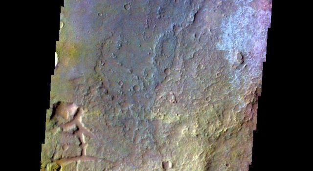The THEMIS camera contains 5 filters. Data from different filters can be combined in multiple ways to create a false color image. This image from NASA's 2001 Mars Odyssey spacecraft shows part of the plains of Margaritifer Terra.