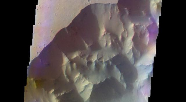 The THEMIS camera contains 5 filters. Data from different filters can be combined in multiple ways to create a false color image. This image from NASA's 2001 Mars Odyssey spacecraft shows part of Ganges Chasma.