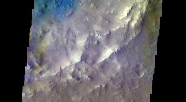 The THEMIS camera contains 5 filters. Data from different filters can be combined in multiple ways to create a false color image. This image from NASA's 2001 Mars Odyssey spacecraft shows the floor of an unnamed crater in Arabia Terra.