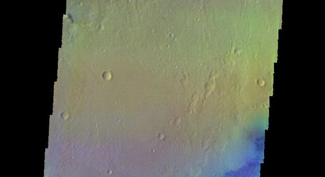 The THEMIS camera contains 5 filters. The data from different filters can be combined in multiple ways to create a false color image. This image from NASA's 2001 Mars Odyssey spacecraft shows part of Gale Crater.