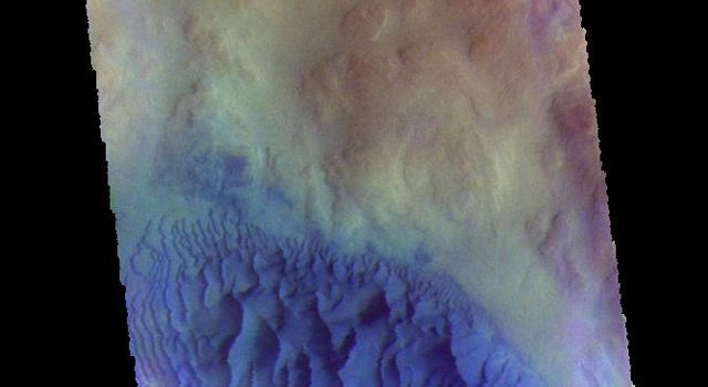 The THEMIS camera contains 5 filters. Data from different filters can be combined to create a false color image. This image from NASA's 2001 Mars Odyssey spacecraft shows a sand sheet with surface dune forms on an unnamed crater in Noachis Terrra.