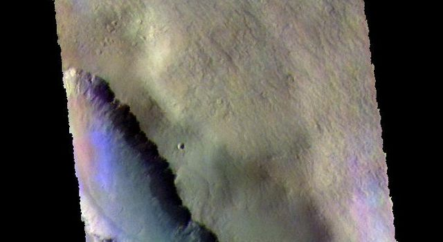 The THEMIS camera contains 5 filters. The data from different filters can be combined in multiple ways to create a false color image. This image from NASA's 2001 Mars Odyssey spacecraft shows part of Asimov Crater.
