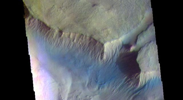 The THEMIS camera contains 5 filters. The data from different filters can be combined in multiple ways to create a false color image. This image from NASA's 2001 Mars Odyssey spacecraft shows more of Asimov Crater.