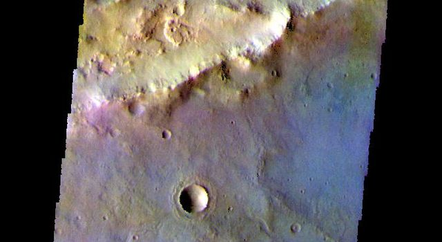 The THEMIS camera contains 5 filters. The data from different filters can be combined in multiple ways to create a false color image. This image from NASA's 2001 Mars Odyssey spacecraft shows part of Sirenum Fossae.