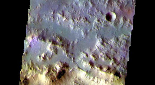 The THEMIS camera contains 5 filters. The data from different filters can be combined in multiple ways to create a false color image. This image from NASA's 2001 Mars Odyssey spacecraft shows part of the northern rim of Horowitz Crater.