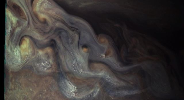 Waves of clouds at 37.8 degrees latitude dominate this three-dimensional Jovian cloudscape, courtesy of NASA's Juno spacecraft. JunoCam obtained this enhanced-color picture on May 19, 2017.
