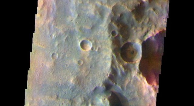 The THEMIS camera contains 5 filters. Data from different filters can be combined in many ways to create a false color image. This image from NASA's 2001 Mars Odyssey spacecraft shows part of the plains of Terra Cimmeria.