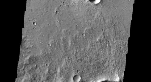Shadows are just right to form googly eyes in this image captured by NASA's 2001 Mars Odyssey spacecraft.