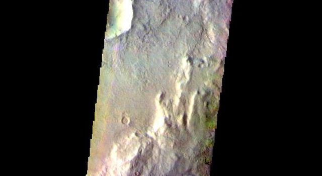 The THEMIS camera contains 5 filters. The data from different filters can be combined in multiple ways to create a false color image. This image from NASA's 2001 Mars Odyssey spacecraft shows part of Corozal Crater.