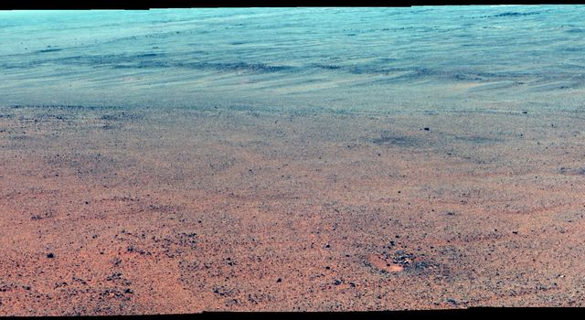 Martian Rocks Lining Possible Ancient Channel (Enhanced Color)