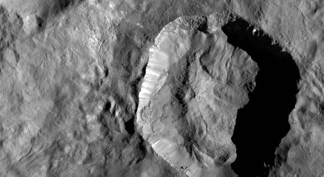 This image high-resolution image of Juling Crater on Ceres, taken by NASA's Dawn spacecraft, reveals, in exquisite detail, features on the rims and crater floor.