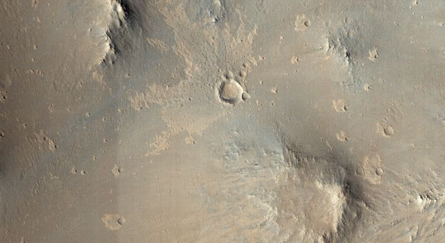 This image from NASA's Mars Reconnaissance Orbiter shows one of millions of small craters and their ejecta material that dot the Elysium Planitia region of Mars.