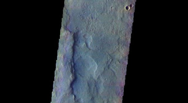 The THEMIS camera contains 5 filters. The data from different filters can be combined in multiple ways to create a false color image. This image from NASA's 2001 Mars Odyssey spacecraft shows part of the plains and highlands of Terra Sirenum.