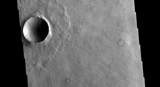 This image captured by NASA's 2001 Mars Odyssey spacecraft shows an unnamed crater in Terra Cimmeria.