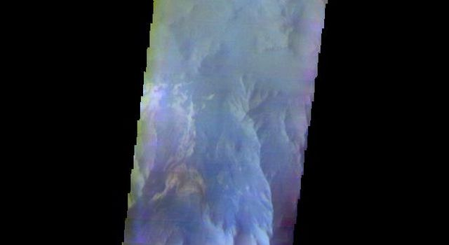 The THEMIS camera contains 5 filters. The data from different filters can be combined in multiple ways to create a false color image. This image from NASA's 2001 Mars Odyssey spacecraft shows part of Coprates Chasma.