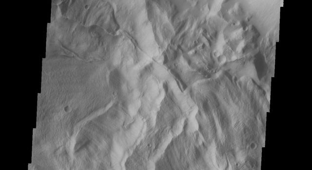 This image captured by NASA's 2001 Mars Odyssey spacecraft shows the eastern portion of Hebes Chasma.