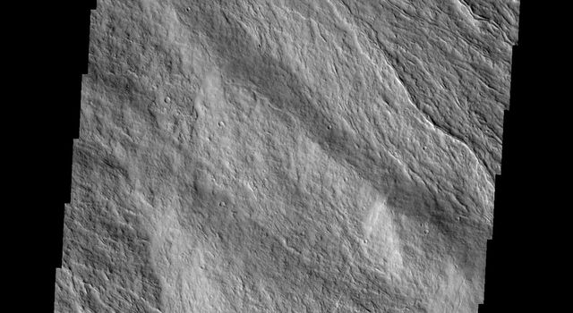 Looking again at the southeastern flank of Mars' Ascraeus Mons, the narrow nature of the flows are visible in this image captured by NASA's 2001 Mars Odyssey spacecraft.