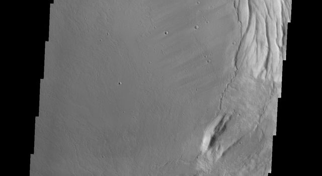 This image captured by NASA's 2001 Mars Odyssey spacecraft shows part of the complex caldera at the summit of Mars' Ascraeus Mons.