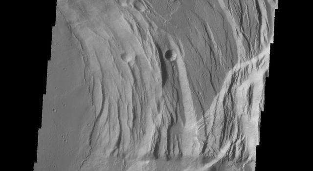 This image captured by NASA's 2001 Mars Odyssey spacecraft shows the eastern part of the complex caldera at the summit of Ascraeus Mons on Mars.