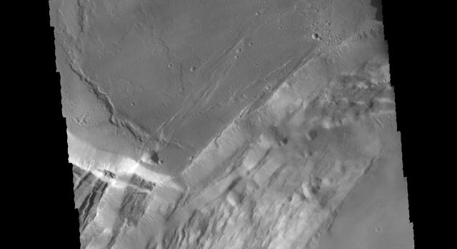 This image captured by NASA's 2001 Mars Odyssey spacecraft shows part of the complex caldera at the summit of Ascraeus Mons on Mars.