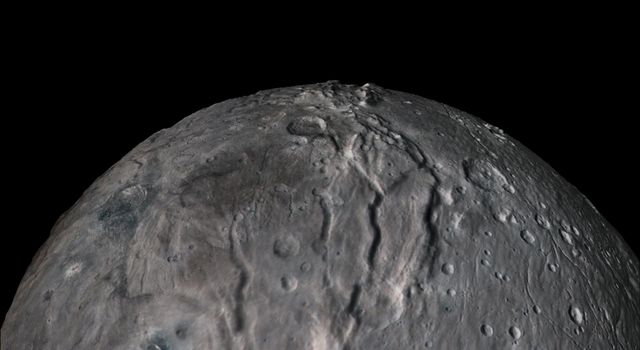 The flight over Charon begins high over the hemisphere NASA's New Horizons saw on its closest approach, then descends over the deep, wide canyon of Serenity Chasma.