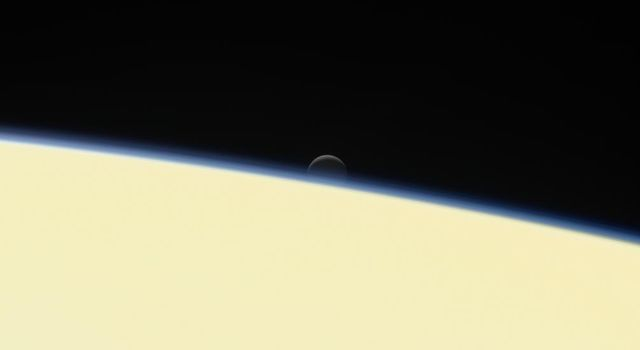 Enceladus Setting Behind Saturn (Image & Movie)