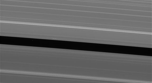 This view of Saturn's A ring features a lone 'propeller,' one of many such features created by small moonlets embedded in the rings as they attempt, unsuccessfully, to open gaps in the ring material, taken by NASA's Cassini spacecraft on Sept. 13, 2017.