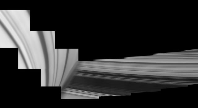 Saturn looms in the foreground of this mosaic of Cassini images, taken by the spacecraft on May 28, 2017. The planet is adorned by ring shadows. The icy rings emerge from behind the planet. The Cassini spacecraft ended its mission on Sept. 15, 2017.