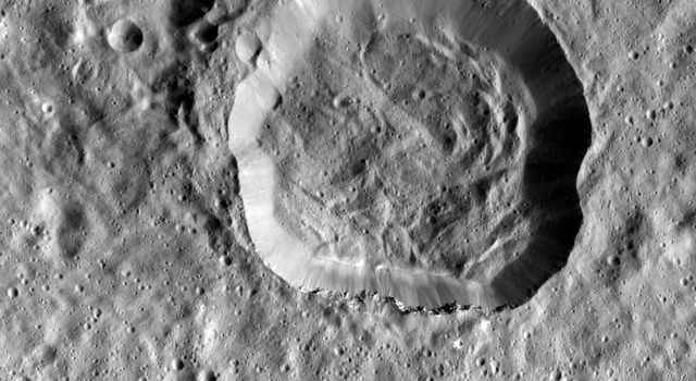 This image taken by NASA's Dawn spacecraft shows Emesh, a crater on Ceres. Emesh, named after the Sumerian god of vegetation and agriculture, located at the edge of the Vendimia Planitia.